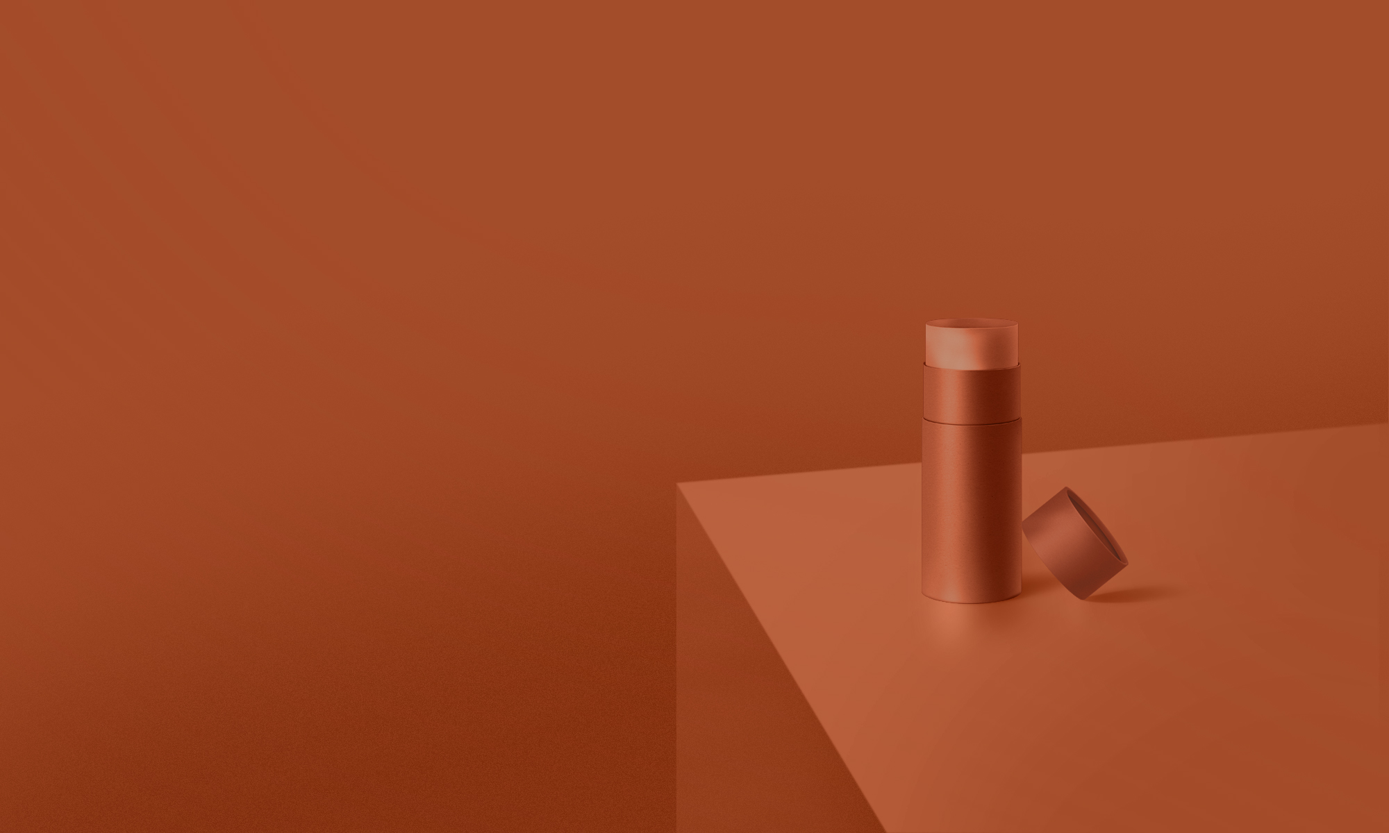 Round canister on dark orange surface in monochromatic environment.