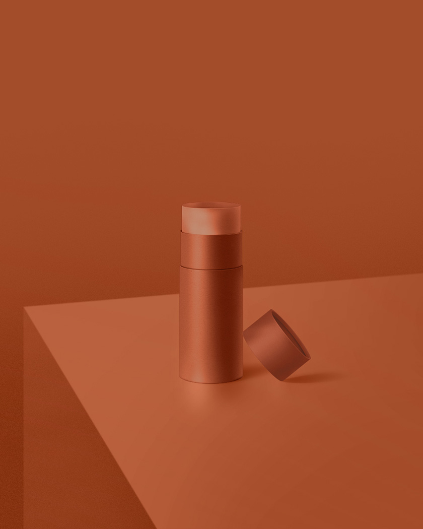 Dark orange monochromatic environment with round canister on flat solid surface.